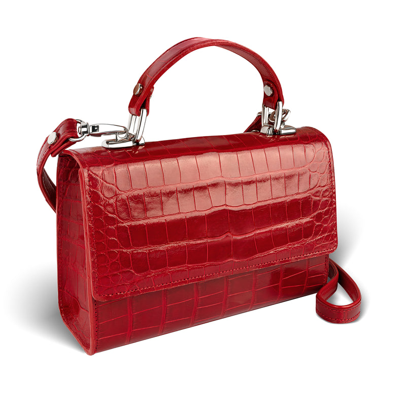 side view of sustainably-sourced, red crossbody handbag in luxurious alligator leather