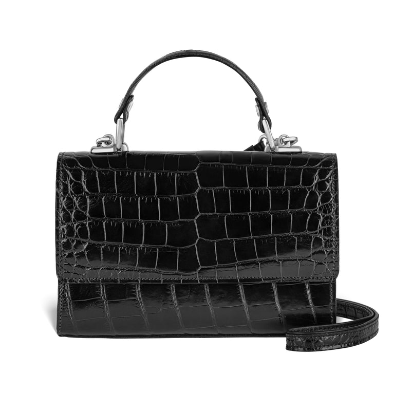 piper & skye black leather top-handle handbag in alligator