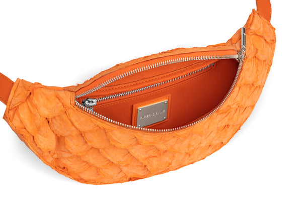 responsible luxury handbag, interior of orange pirarucu belt bag from piper & skye