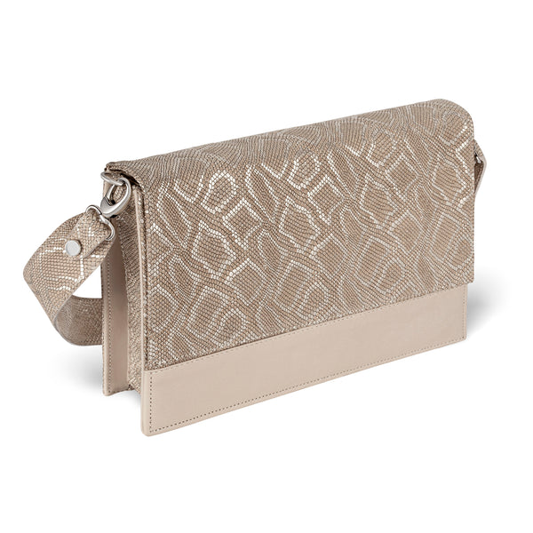 side view of front view of Piper & Skye gold embossed leather crossbody handbag