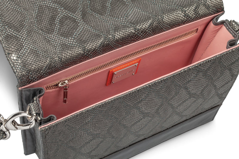 side view of Gunmetal python embossed leather handbag