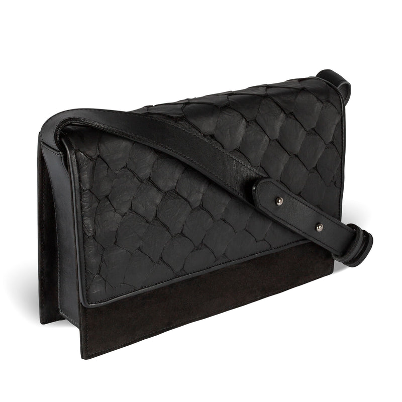 Side view of Piper & Skye Pirarucu leather handbag in black