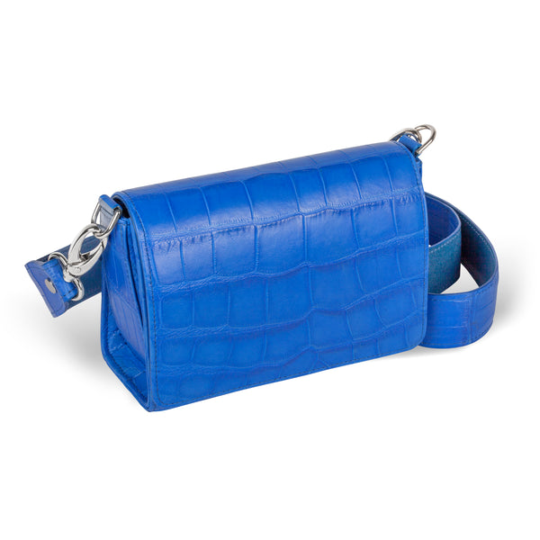 side view of luxury handbag in cobalt leather with crossbody strap