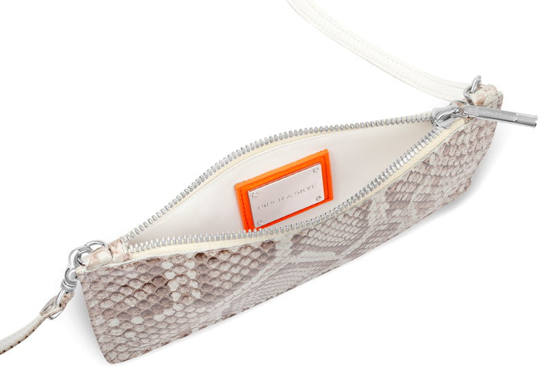 interior view of piper & skye luxury python crossbody
