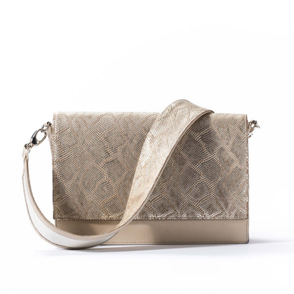 front view of Side view of embossed leather handbag with crossbody strap