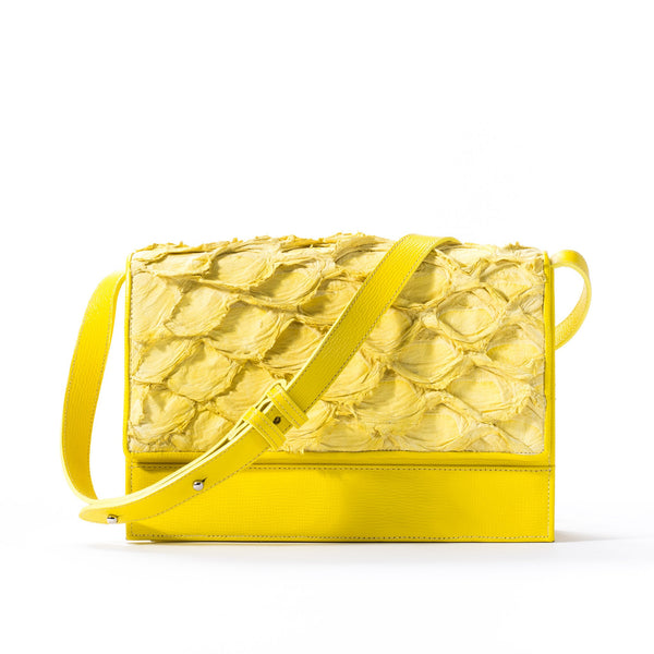 Front view of responsibly luxury, yellow pirarucu leather handbag by Piper & Skye