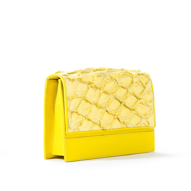 Side view of Piper & Skye's Pirarucu leather Brava Handbag in yellow