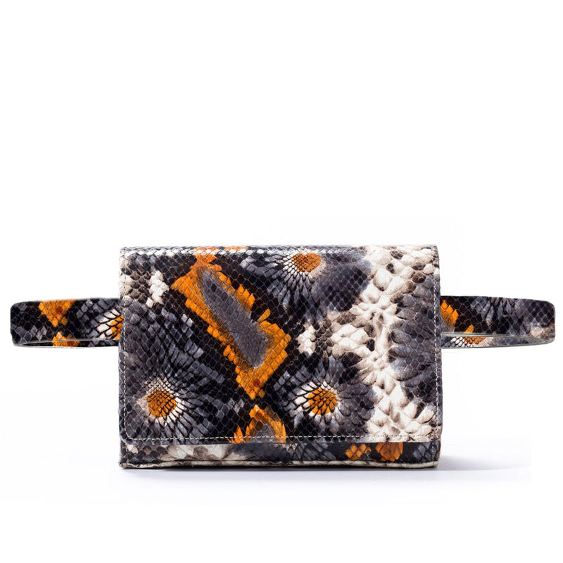 responsible luxury belt bag in floral embossed leather