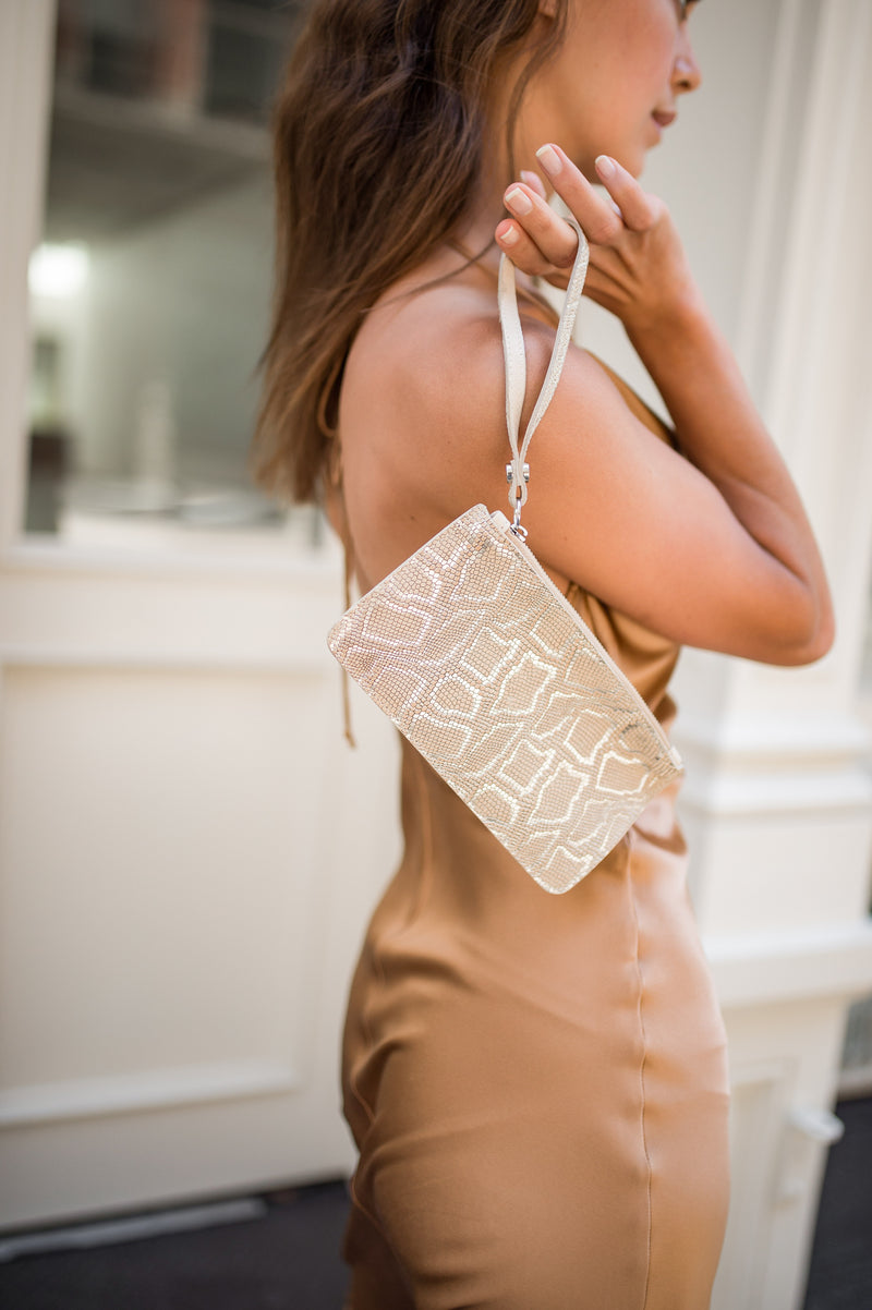 piper & skye gold leather wristlet in soho, nyc