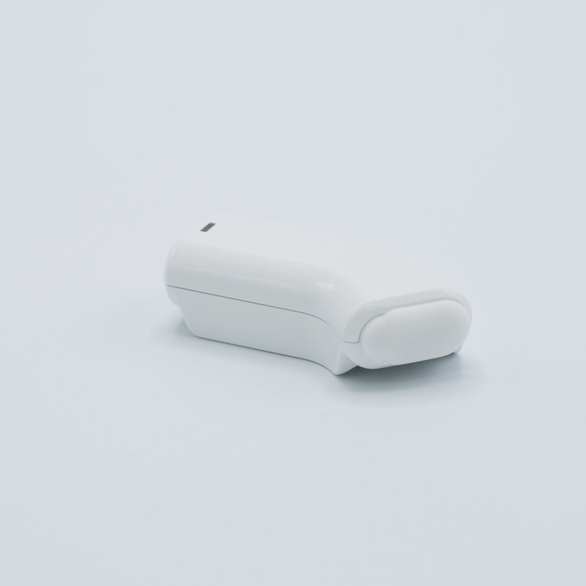 White Wireless Earbud Charging Clip