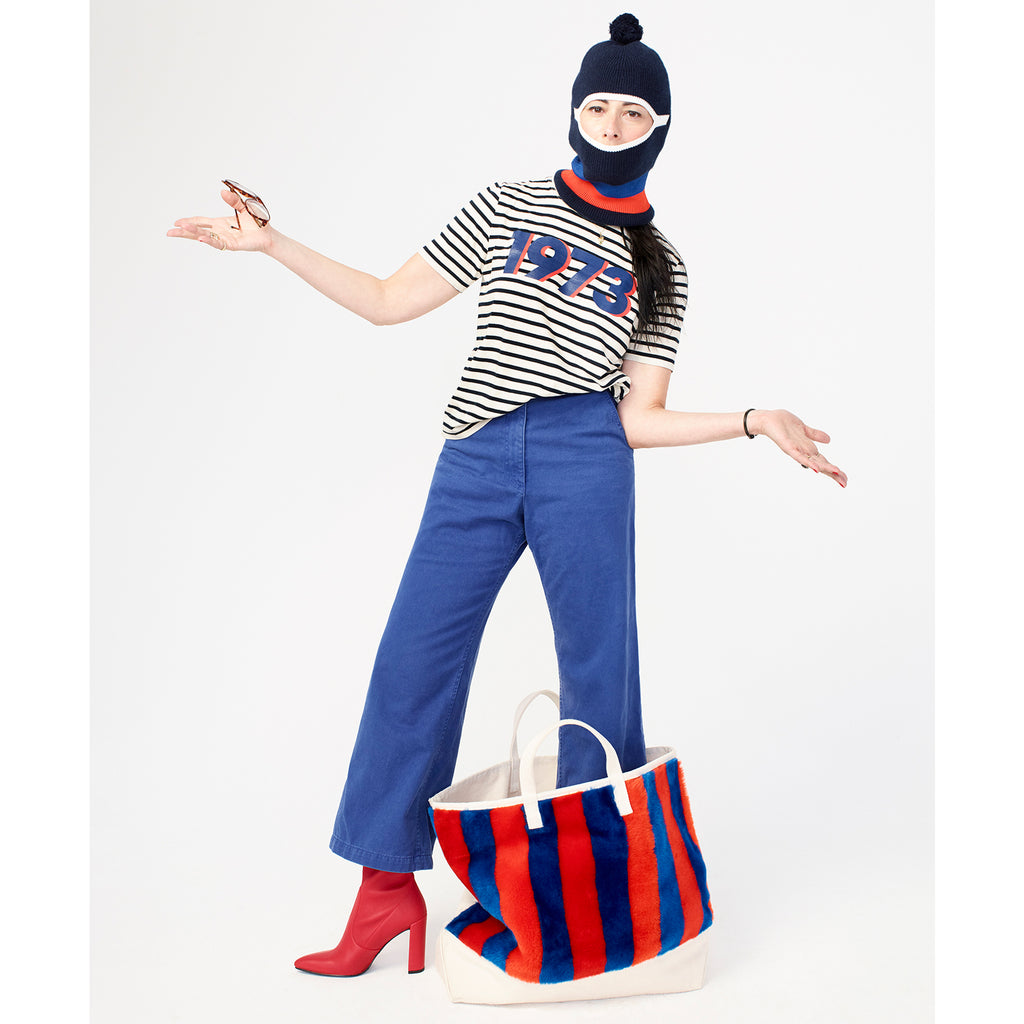 The Modern 1973 - White/Royal/Poppy on Model with Hat, Jeans, Red Boots and Faux Fur Tote