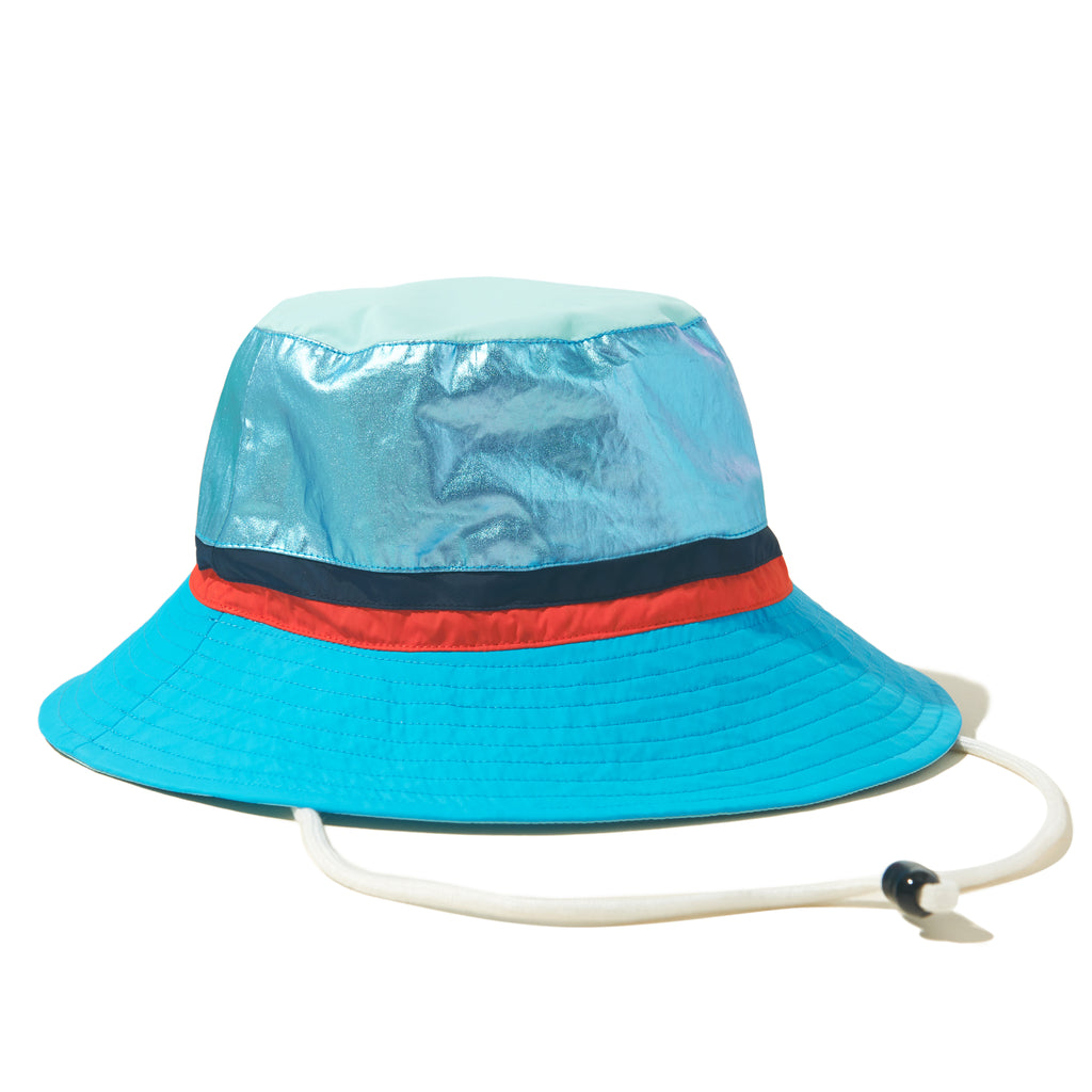 The Buck - Blue Flat, blue hat, metallic blue top, navy/poppy stripe band, shown with drawstring