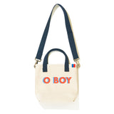 The O BOY Bucket Flat, Canvas crossbody with o boy writing in poppy with blue shadow
