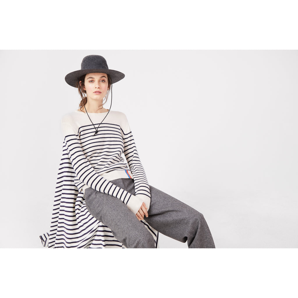 The Sophie in cream/navy on model, paired with grey pants, hat and more stripes