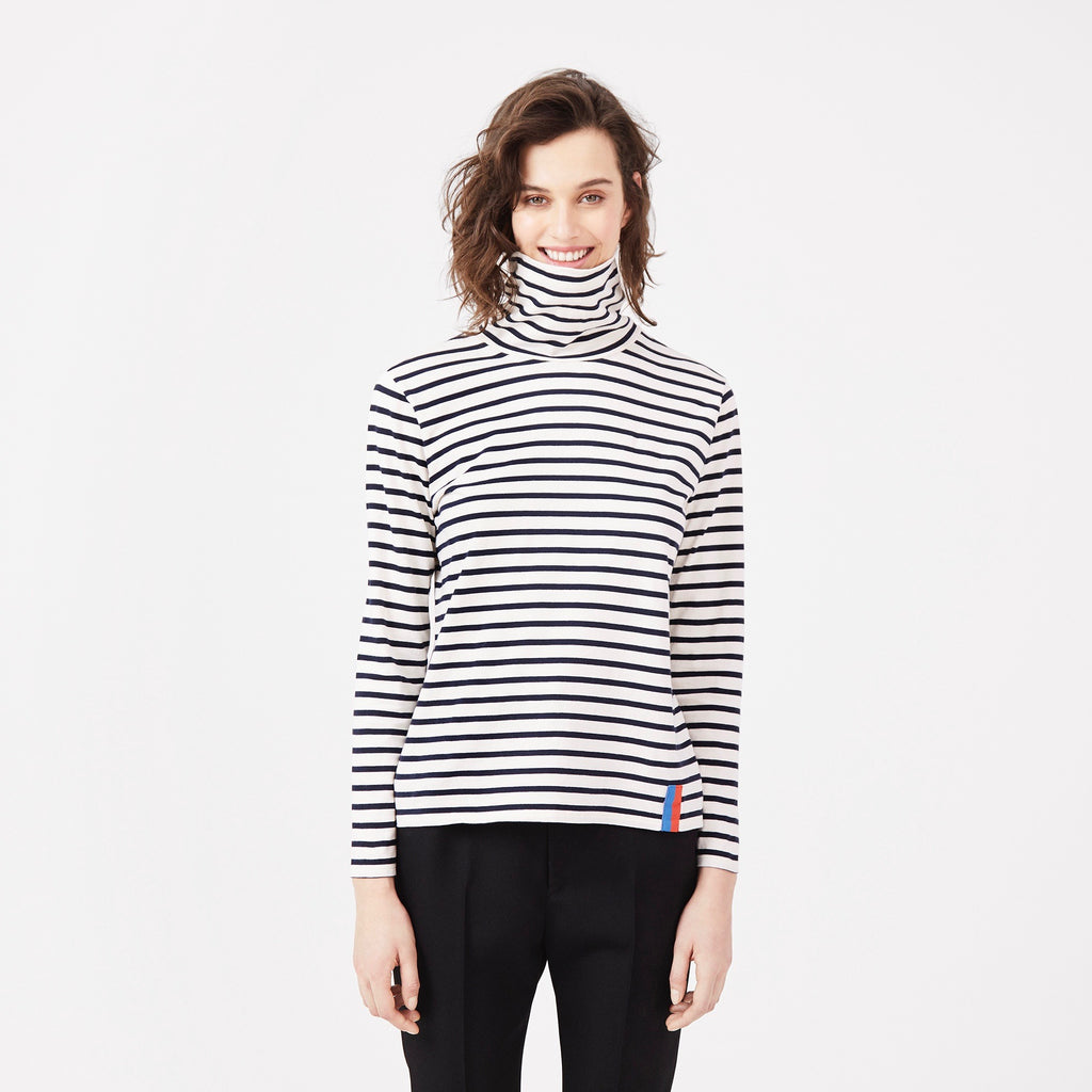 The Turtleneck in Cream/Navy on Model with Black Pants