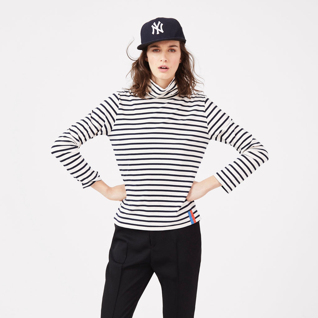The Turtleneck in Cream/Navy on Model with Black Pants and Yankees Hat