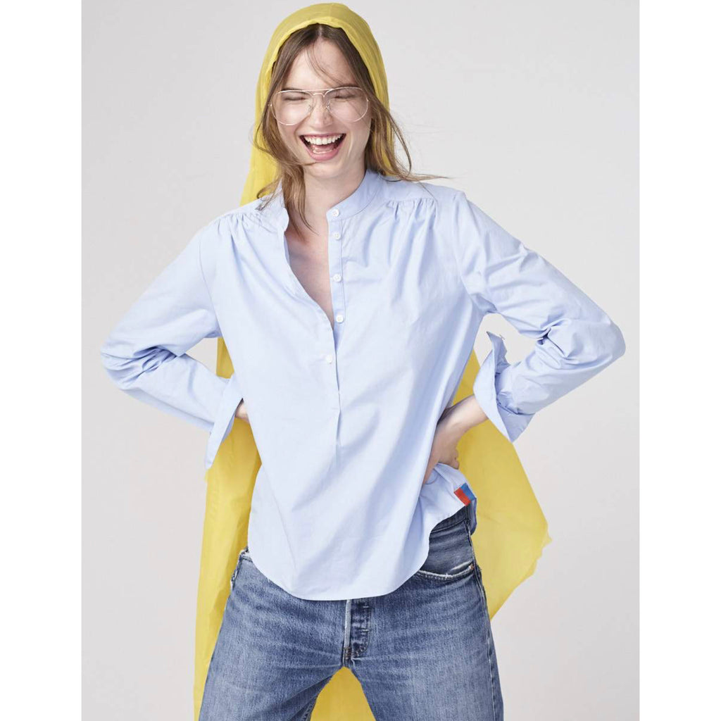 The Brooke - Blue on model with jeans and yellow rain coat