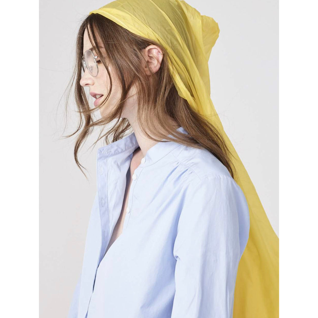 The Brooke - Blue on model with jeans and yellow rain coat side shot
