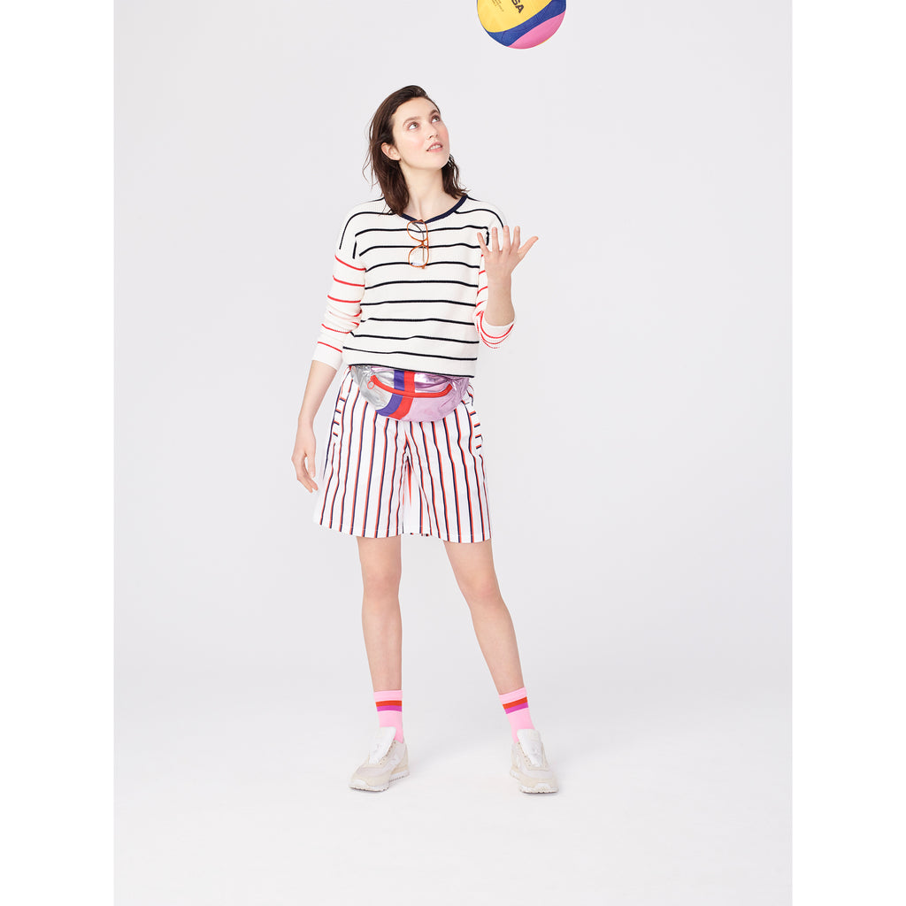 Model wearing The Fanny - Pink, paired with striped tee and shorts