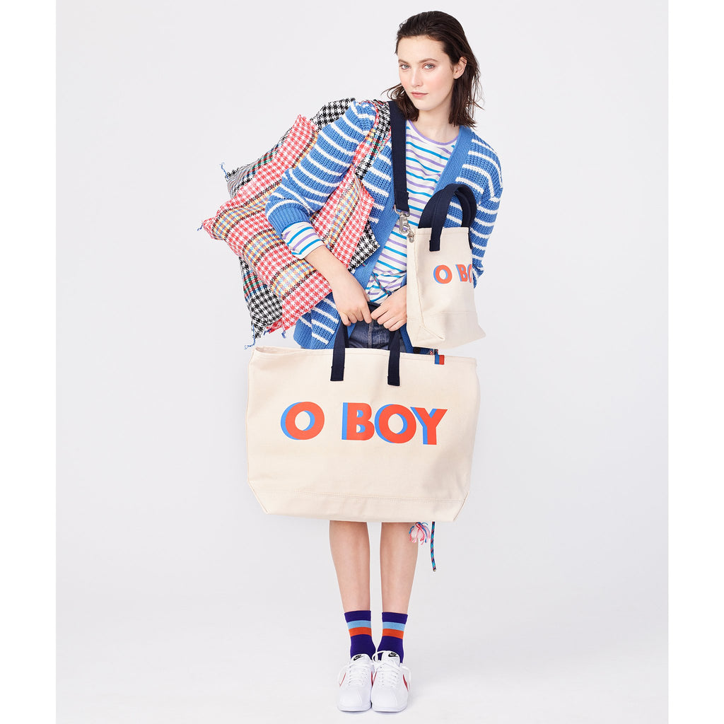 The O BOY Tote - Canvas Flat, Canvas tote with o boy writing in poppy with blue shadow shown with model