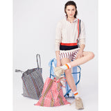 The Albers - Cream Flat - Cream Sweater with Navy and Red Stripe, paired with striped shorts and beach bags