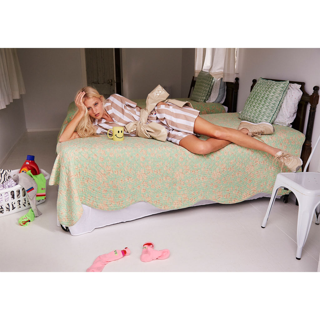 The Roxy - Beige on model, with matching Tina Top shown on bed
