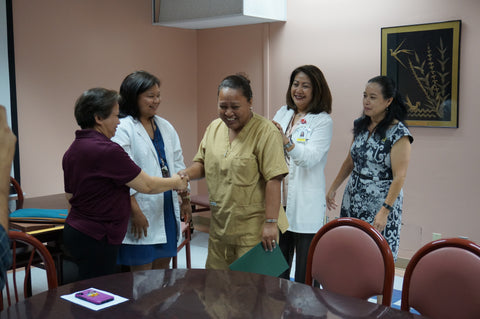 Mary Victor, a nurse midwife from Pohnpei State Hospital, receives a certificate of completion following her 10-day training at Guam Memorial Hospital.