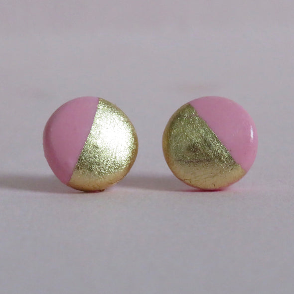 Bright pink and gold studs