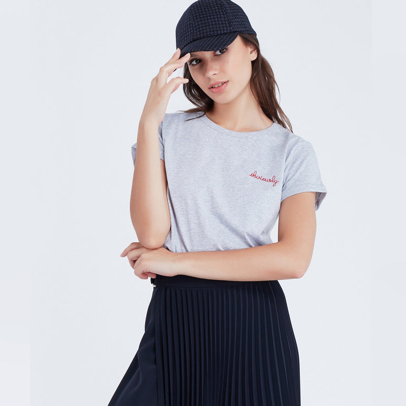 Woman wears 'Obviously' Slogan tee by Maison Labiche