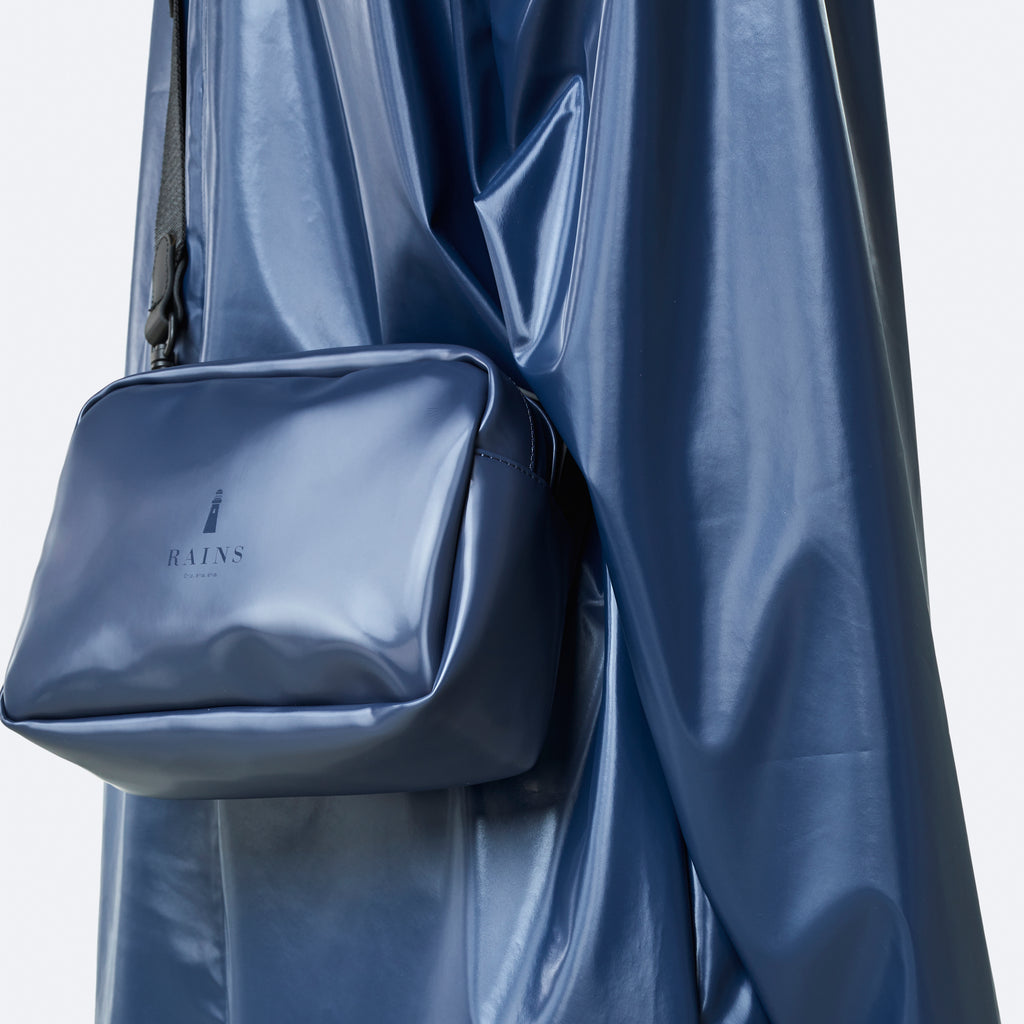 Rains Box Bag & A-Line jacket in Shiny Blue, available at ALC Edinburgh