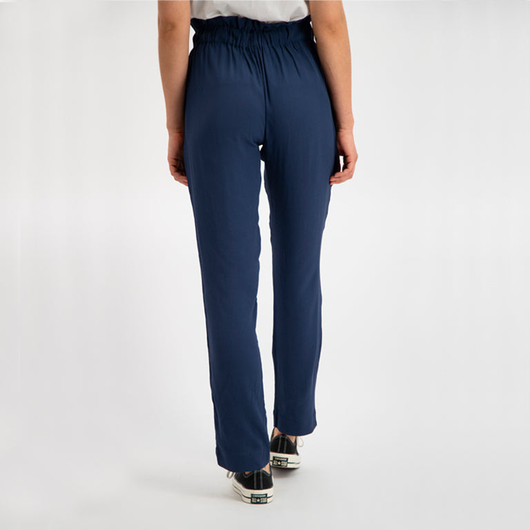 Woman wearing Coast Pants in Navy by Denham