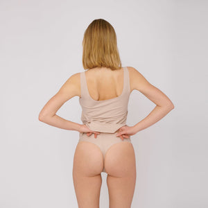 Organic Basics cheeky thong in Black, worn by the brands model, Nanna.