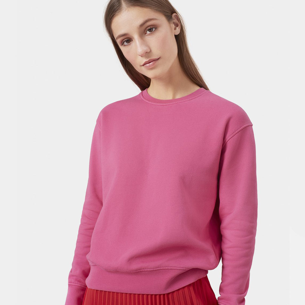 Woman wears Bugglegum pink sweater by Colorful Standard