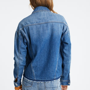 Woman wearsRaw hem Cape denim jacket by Denham