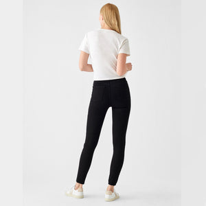 Woman wears Farrow skinny in Black by DL1961