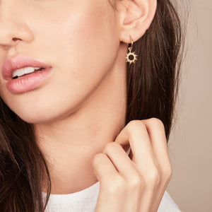 Woman wearing Gold Eternal Sun mini Hoop Earring by Rachel Jackson