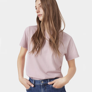 Woman wearing Classic Organic Light tee in Faded Pink by Colorful Standard