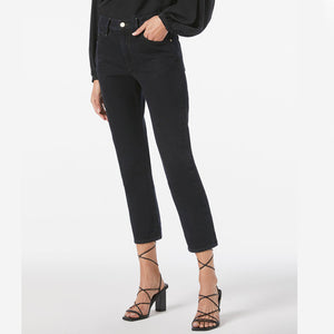 Woman wears le piper jeans in black by Frame