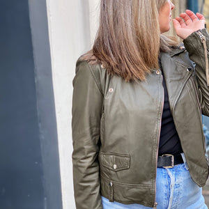 Gill wears the MDK Seattle thin biker jacket in Green