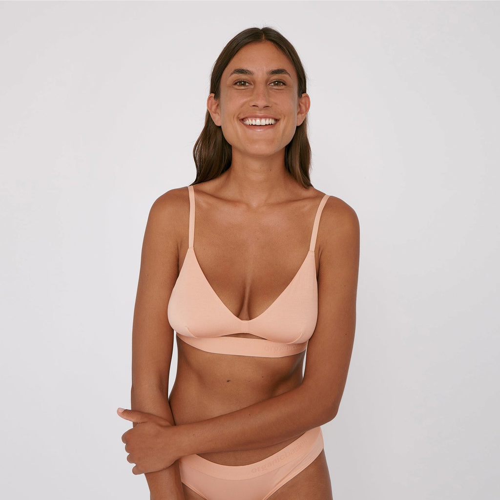 Wilma wears the Lite Bralette by Organic Basics in Soft Pink
