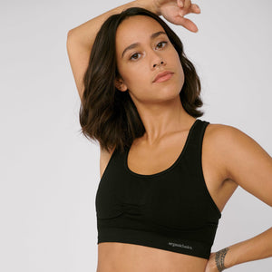 Tamara wears the Active workout bra in black by Organic Basics