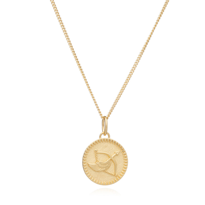 Girl wears Gold Zodiac Necklace by Rachel Jackson