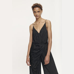 Woman wearing the Dance Jumpsuit in Black by Samsoe  Samsoe