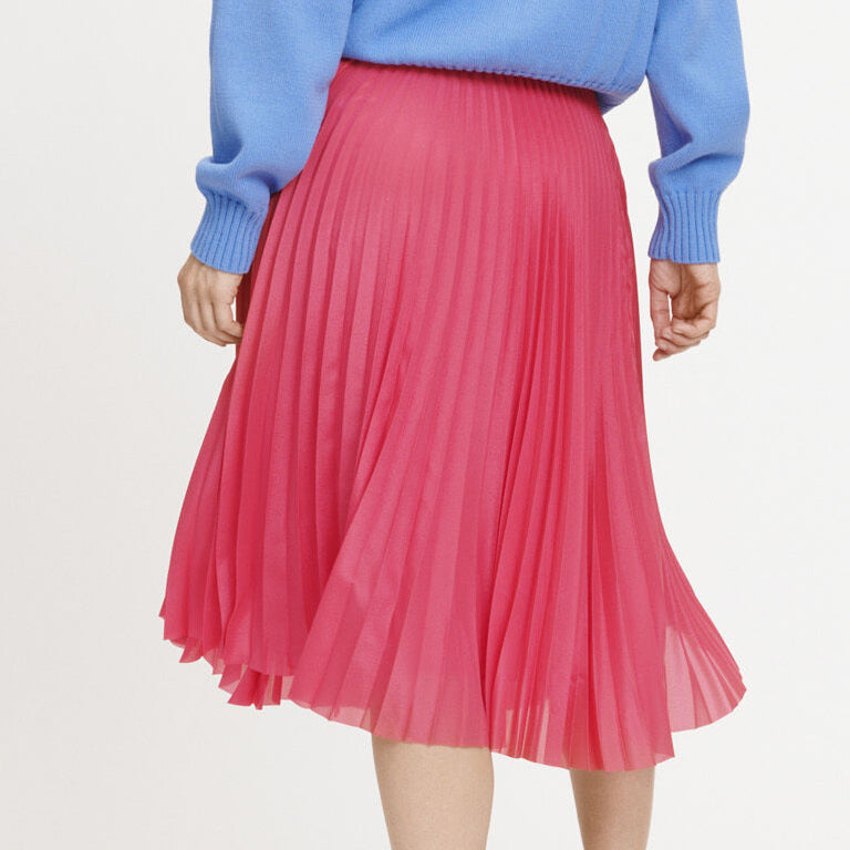 woman wearing skirt in pink by Samsoe & Samsoe