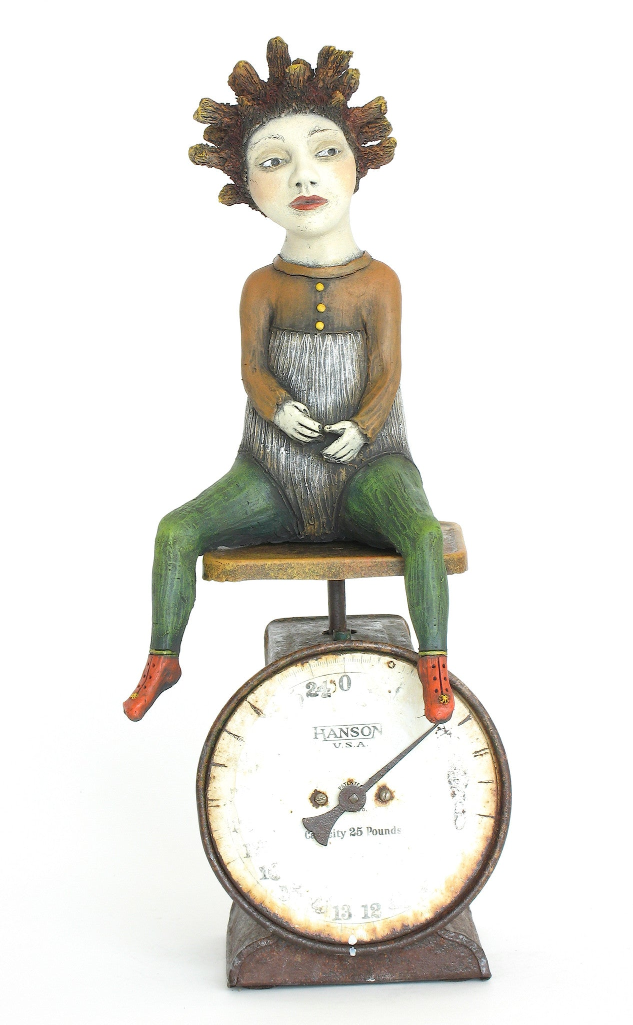 "SOLD  ""Weighing the Consequences""  original ceramic sculpture with antique scale by Jacquline Hurlbert"
