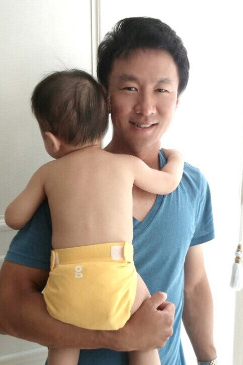 Mike and his good morning sunshine clad baby