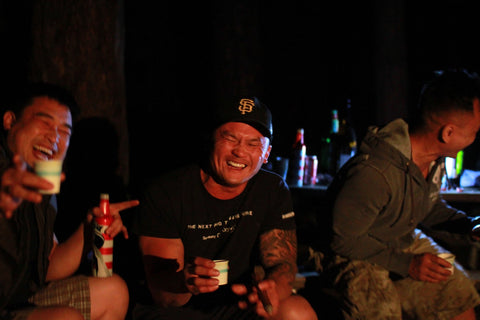 drinking and laughing at camp