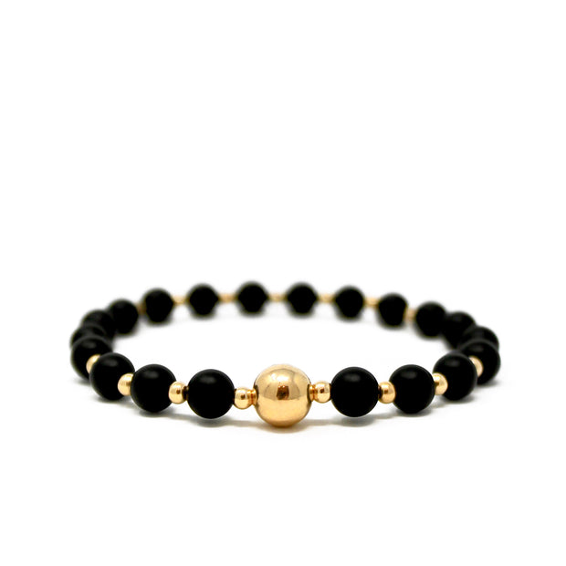 The Tommy bracelet. 14k gold filled. Stretch elastic cord. Non tarnish. Water safe. Matte black onyx.
