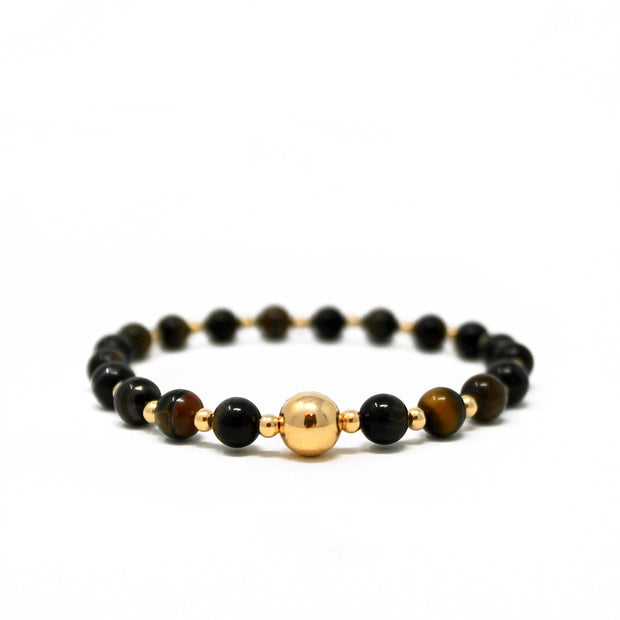 The Tommy bracelet. 14k gold filled. Stretch elastic cord. Non tarnish. Water safe. Green tigers eye.