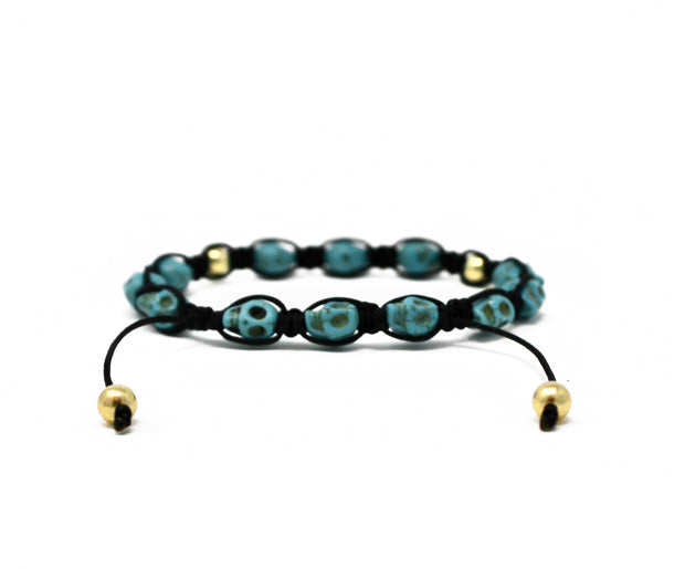 Happy skulls bracelet. 14k gold filled. Black nylon cord. Turquoise howlite beads. Macramae.